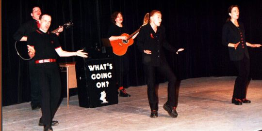 Opening song from the 'What's Going On?' show, sometime in the 90s. Garry Fox and Wendy Parkin on guitars; Nigel Wild, Angela Carr and Lizzie Lewendon in front